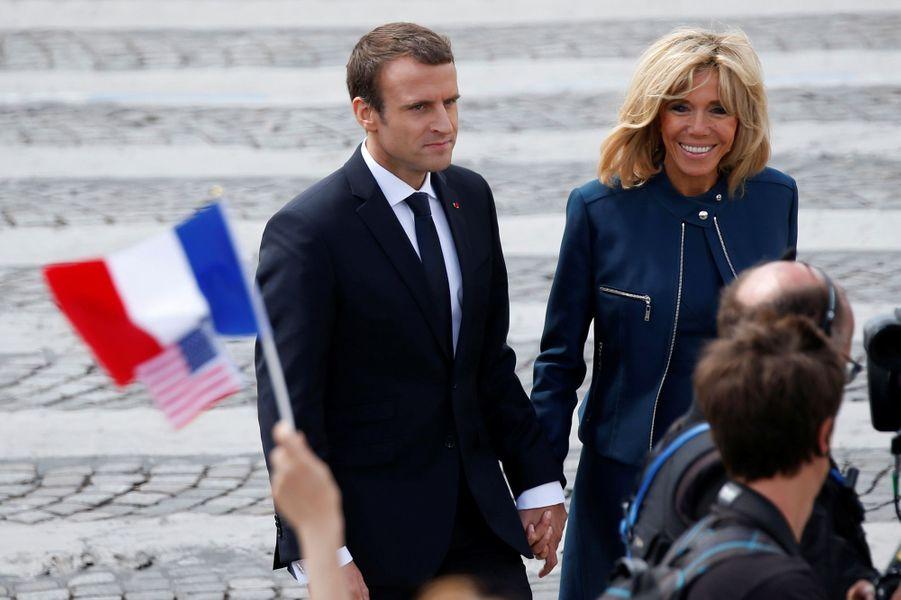 Emmanuel et Brigitte Macron après le défilé du 14 juillet sur les Champs-Elysées.