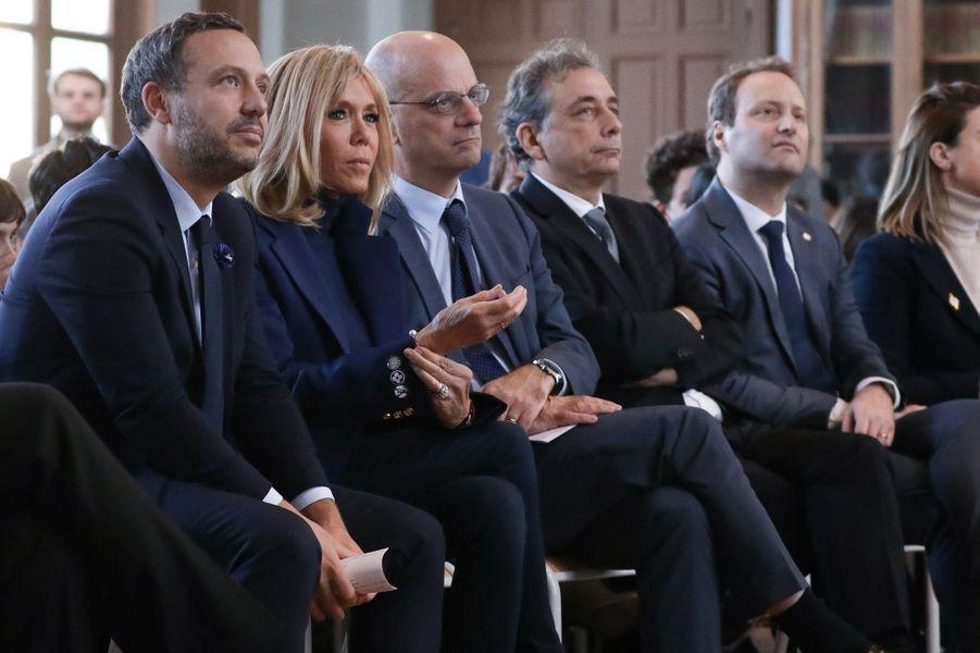 AdrienTaquet, Brigitte Macron et Jean-Michel Blanquerau collège Chaptal, à Paris,à l'occasion de la Journée nationale de lutte contre leharcèlementscolaire.