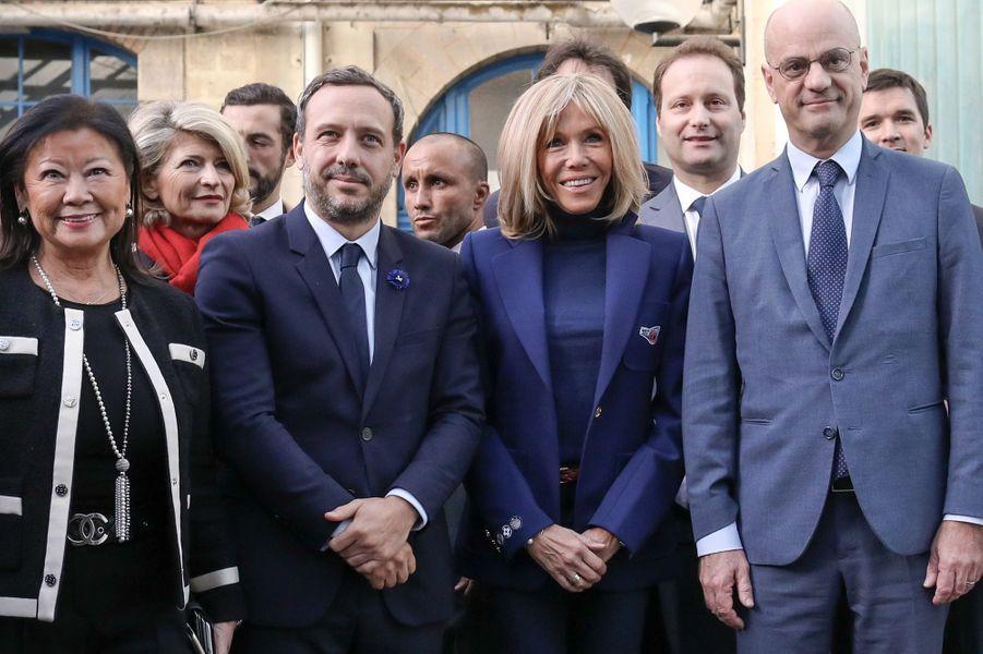 Jeanne d'Hauteserre, maire du VIIIe arrondissement de Paris, AdrienTaquet, Brigitte Macron et Jean-Michel Blanquerau collège Chaptal, à Paris,à l'occasion de la Journée nationale de lutte contre leharcèlementscolaire.