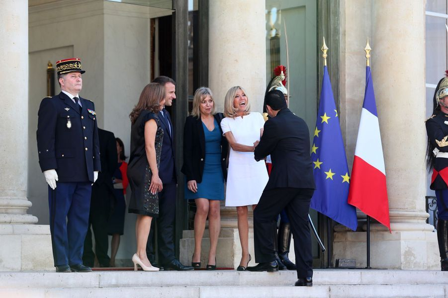 Emmanuel et Brigitte Macron à l'Elysée le 8 juin en compagnie du président du Guatemala Jimmy Morales et sa femme, Hilda Patricia Morales.