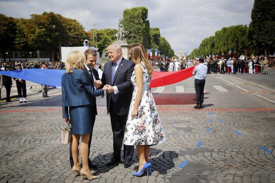 Le couple Trump et le couple Macron lors du défilé du 14 juillet, place de la Concorde.