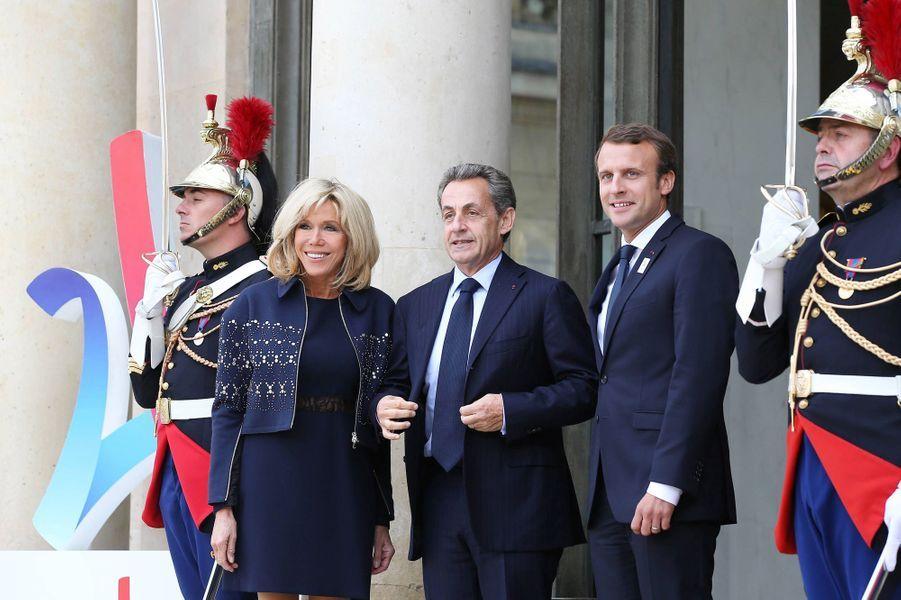 Brigitte Macron, Nicolas Sarkozy et Emmanuel Macron à l'Elysée pour fêter le succès de Paris 2024,le 16 septembre 2017.