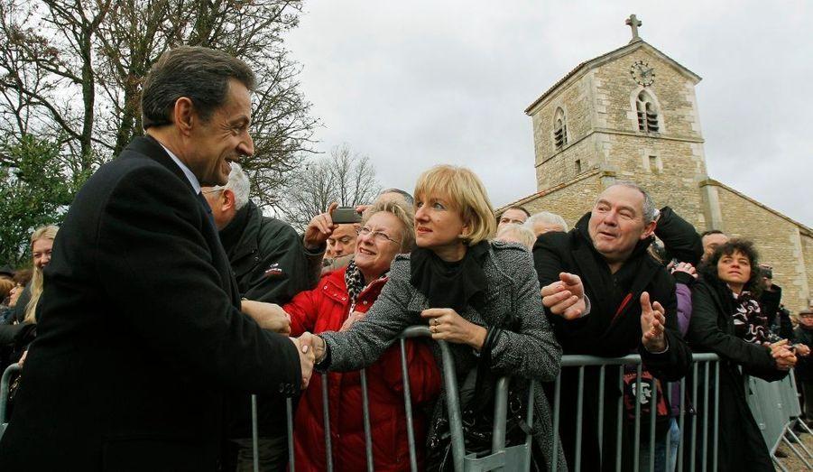 Lors de sa visite à Domrémy-le-Pucelle, le chef de l'Etat a été accueilli par des habitants de la région.