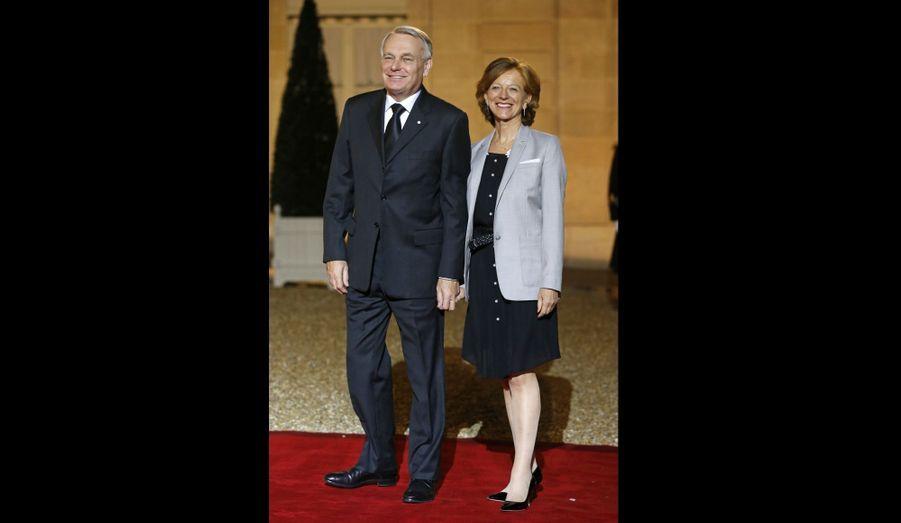 Le Premier ministre est arrivé au bras de son épouse Brigitte.