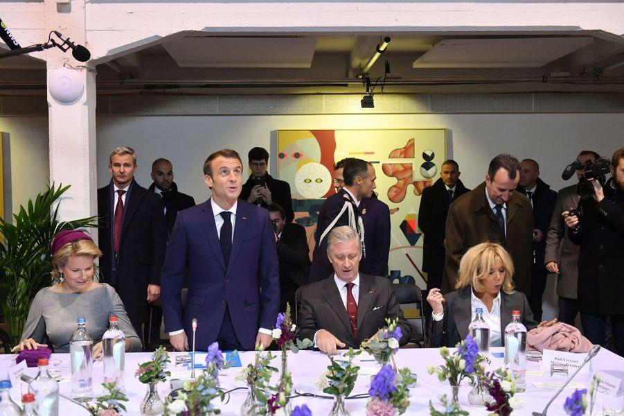 Le roi des Belges Philippe, la reine Mathilde, Emmanuel et Brigitte Macron à Molenbeek.
