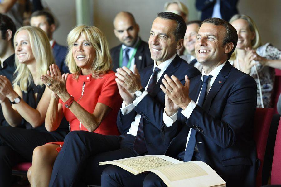 Emmanuel et Brigitte Macron assistent à une masterclass du pianisteDominique Merlet, aux côtés du chancelier Christian Kern et de son épouse Eveline.