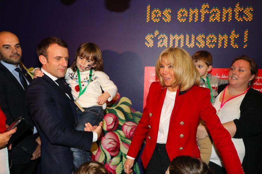 Emmanuel et Brigitte Macron au «Noël de l'Elysée» à la Manufacture des Gobelins, le 19 décembre 2018.