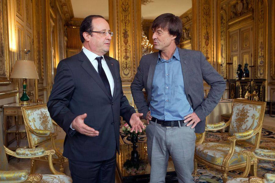 François Hollande et Nicolas Hulot à l'Elysée en décembre 2012.Pendant trois ans, il sera «envoyé spécial pour la planète», avec un bureau au palais présidentiel.