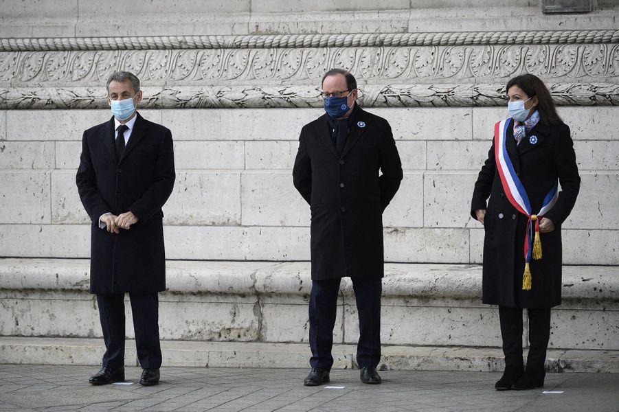 Nicolas Sarkozy, François Hollande et Anne Hidalgolors de la cérémonie à l'Arc de Triomphe.