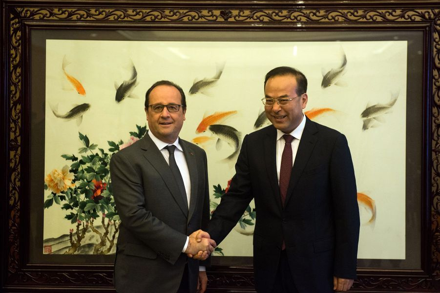 Le Président français avec le secrétaire du parti de Chongqing, Sun Zhengcai