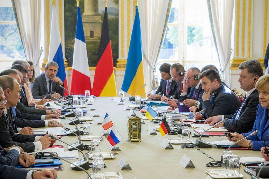 Hollande, Poutine, Merkel ensemble pour la paix