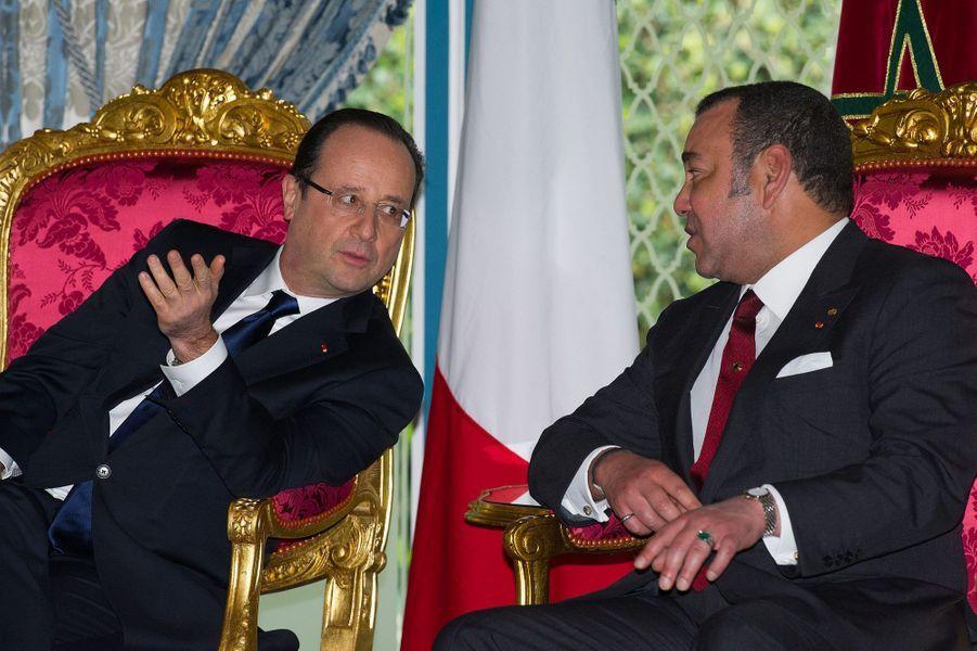 François Hollande avec le roi, lors de sa précédente visite en avril 2013