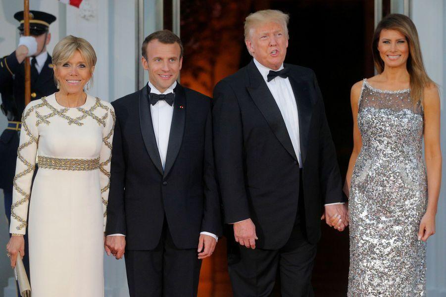 Brigitte Macron, Emmanuel Macron, Donald et Melania Trump mardi soir à la Maison-Blanche pour le dîner d'Etat en l'honneur du couple présidentiel français.