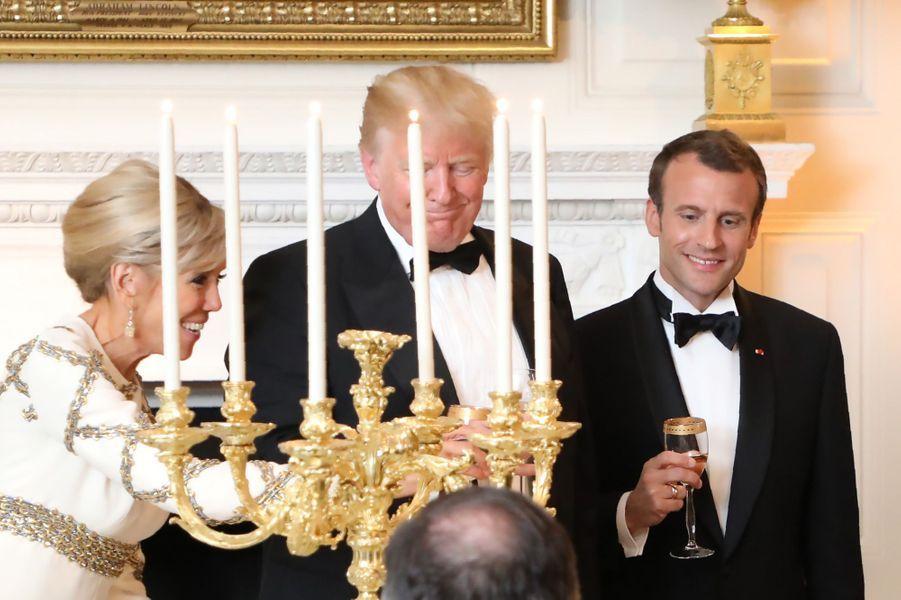 Brigitte Macron, Donald Trump et Emmanuel Macron mardi soir au dîner d'Etat à la Maison-Blanche.