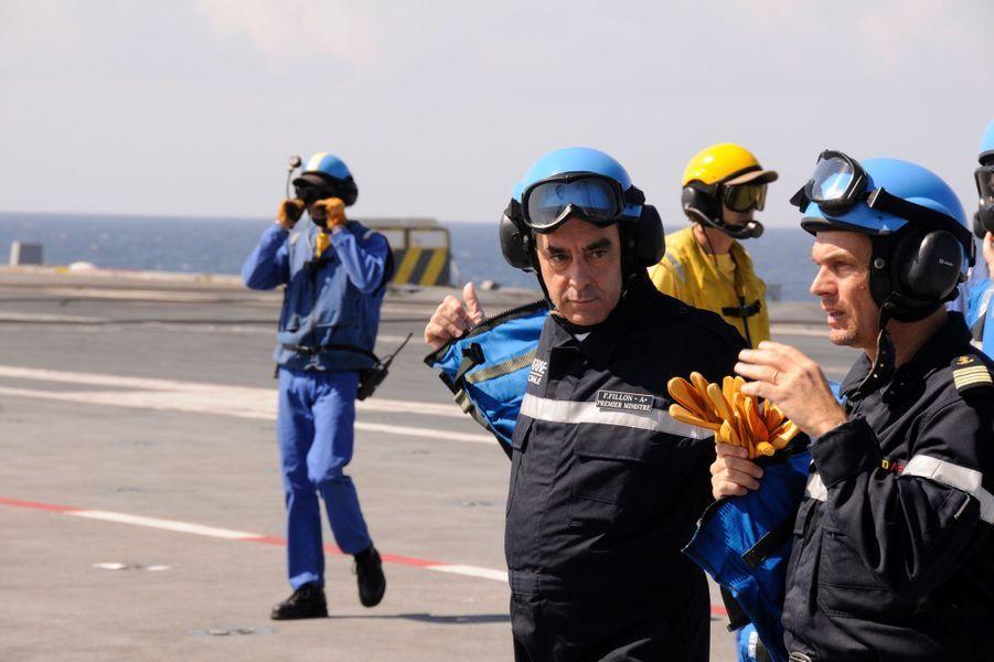 En février 2011, le Premier ministre profite de sa visite en Arabie Saoudite pour rencontrer les marins français embarqués sur le Charles-de-Gaulle. Au large de Djedda, il a assisté à des exercices de catapultage et d'appontage d'avions de chasse.