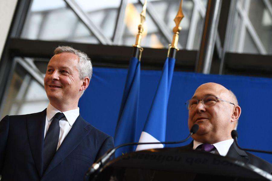 Bruno Le Maire, nouveau ministre de l'Economie et Michel Sapin.