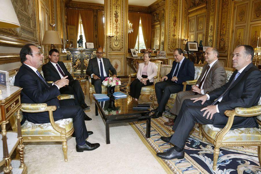 Francois Hollande, Manuel Valls et Jean-Christophe Cambadelis
