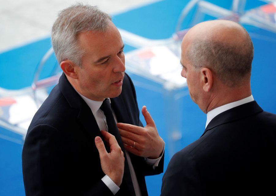 François de Rugy discute avec Jean-Michel Blanquer, dimanche lors du défilé du 14-Juillet.