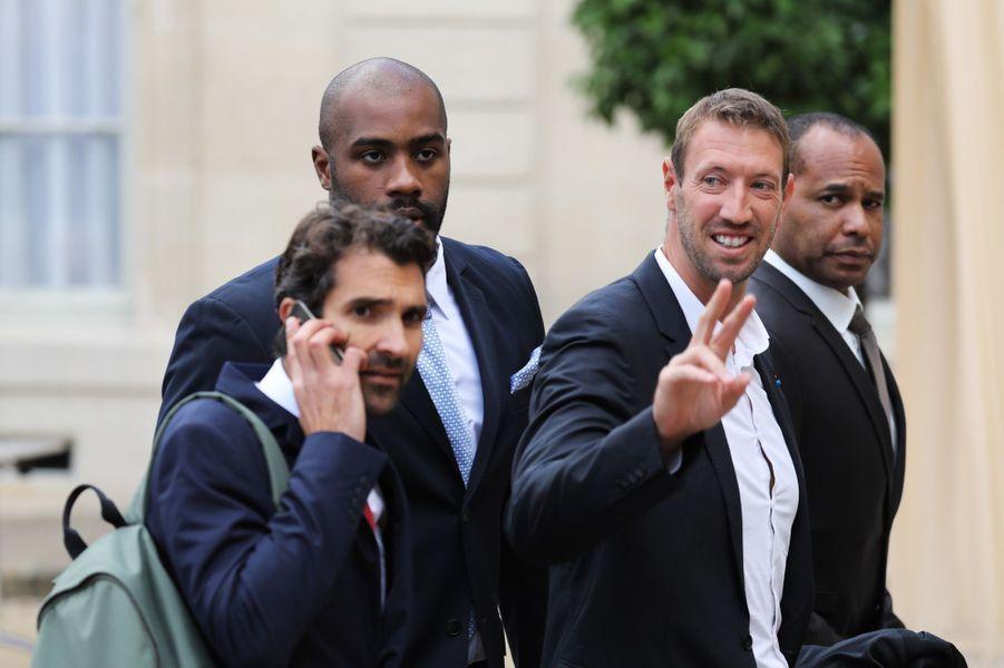 Teddy Riner et Alain Bernard à l'Elysée pour fêter lesuccès de Paris 2024.