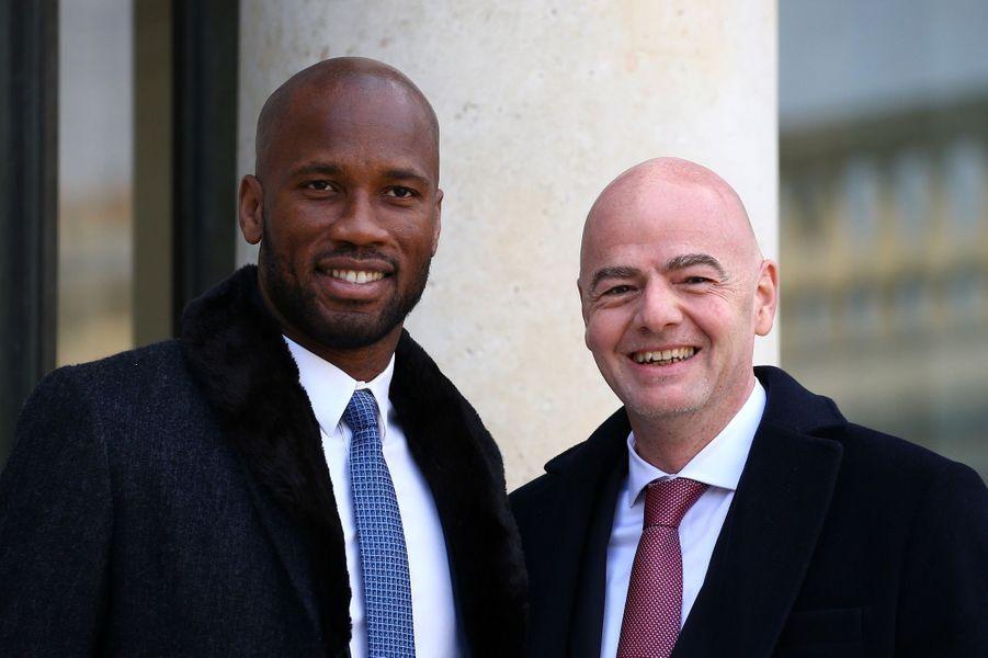 Didier Drogba et le président dela Fifa, Gianni Infantino, mercredi à l'Elysée.