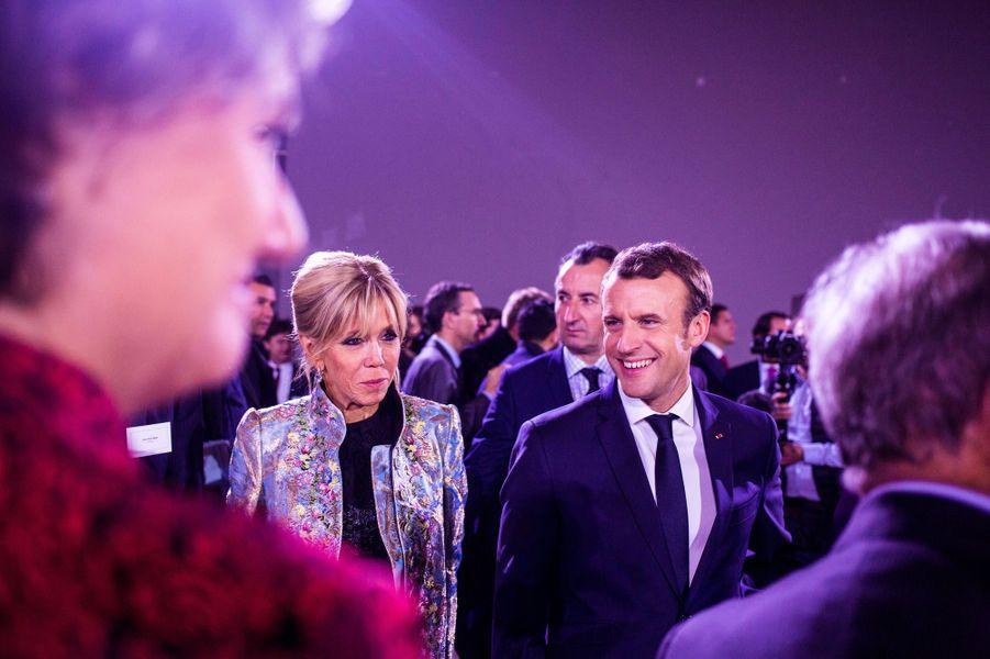 Brigitte et Emmanuel Macron au dînerBloomberg au Grand Palais, lundi soir.