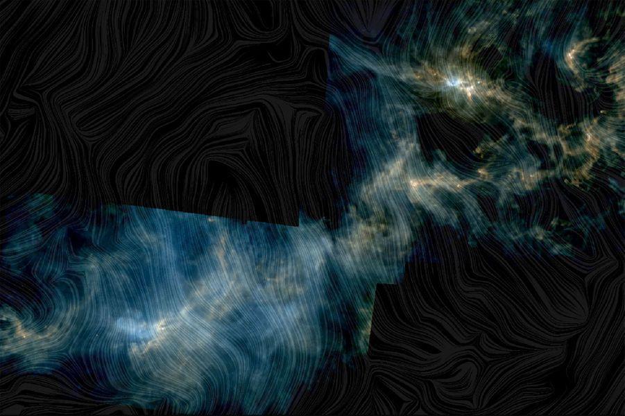 Juillet. Cette image montre le nuage moléculaire Perseus, basé sur une combinaison de données des télescopes spatiaux Herschel et Planck de l'ESA.