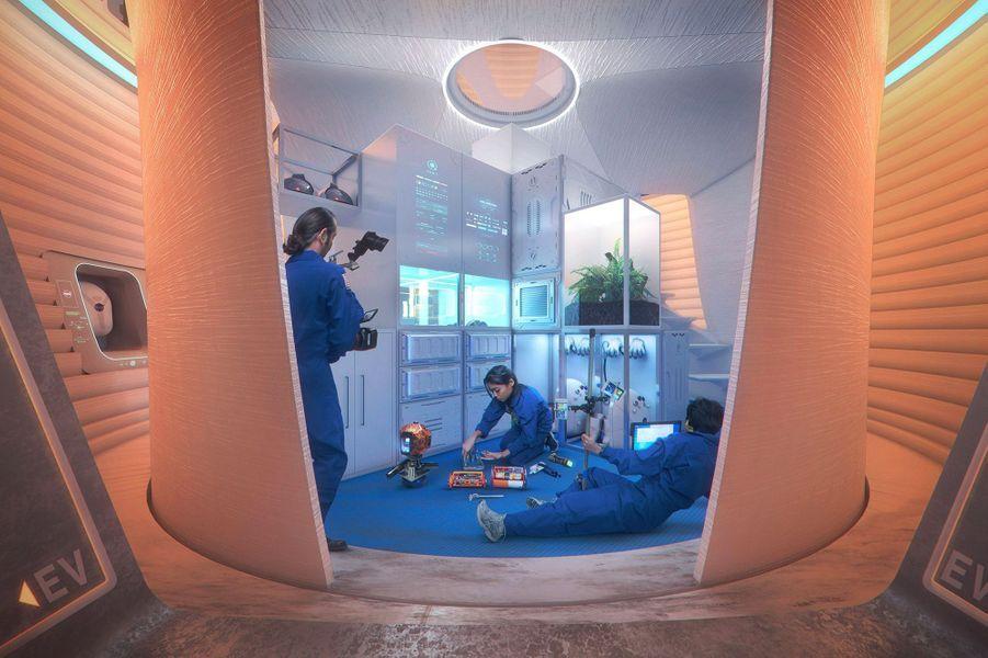 AI. SpaceFactory, New York : Pour eux, la maison martienne doit s'adapter parfaitement à son environnement. Ils ont présenté une maison cylindrique à trois étages qui serait imprimée avec des matériaux issus de Mars.