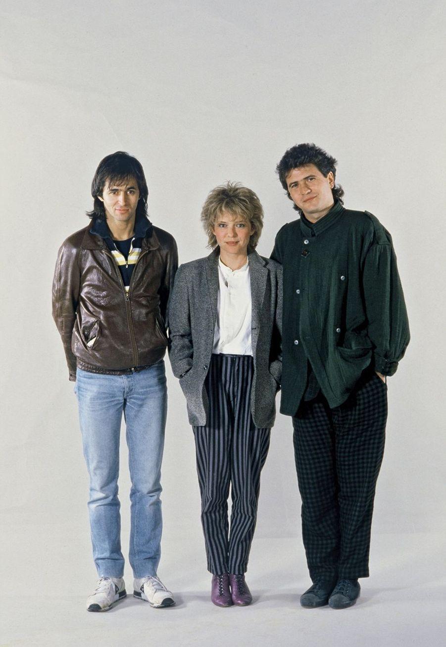 De g. à dr., Jean-Jacques Goldman, France Gall et Daniel Balavoine réunis pour un concert caritatif en 1985.