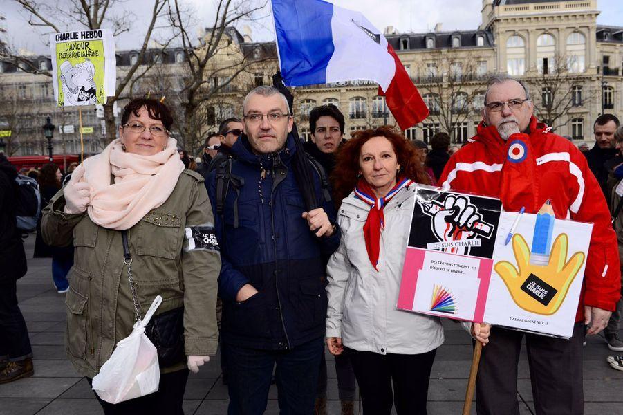 Notre photographe Philippe Petit a immortalisé quelques visages parmi les millions de Français qui ont défilé en soutien des victimes des attaques terroristes de la semaine dernière et pour défendre la liberté d'expression.
