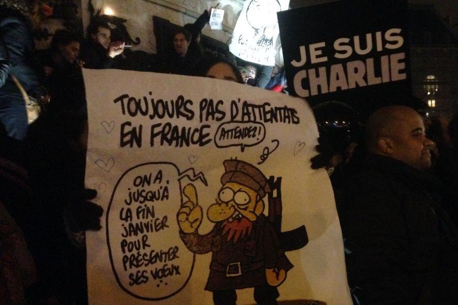 Ce dessin, paru dans l'édition du matin même de Charlie Hebdo, de nombreux manifestants le perçoivent comme prémonitoire. Dessiné par Charb, l'une des victimes, il présente un terroriste promettant un attentat avant la fin du mois de janvier.