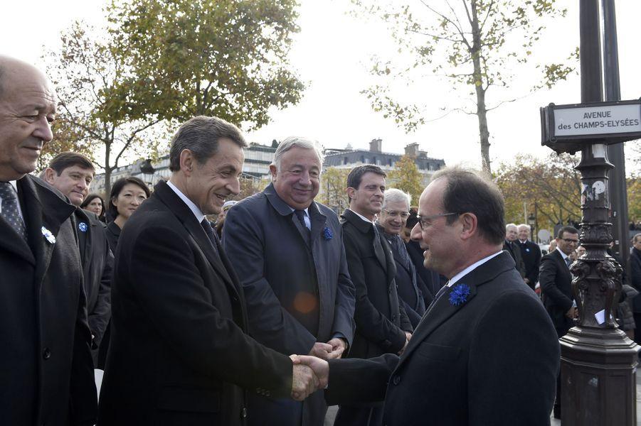 François Hollande et Nicolas Sarkozy sur les Champs-Elysées pour la cérémonie du 11 novembre