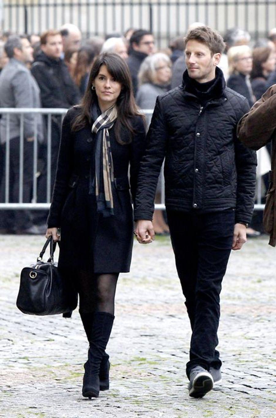 Marion Jollès et Romain Grosjean à l'hommage à Christophe de Margerie qui a été rendu au sein de l'église Saint-Sulpice à Paris