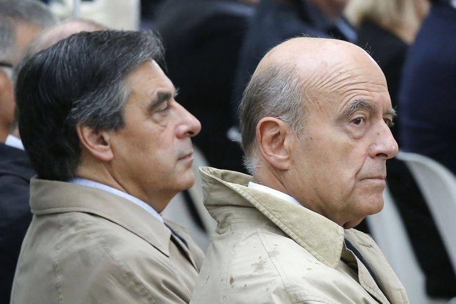 François Fillon et Alain Juppéàla cérémonie d'hommage aux victimes du terrorisme aux Invalides, le 19 septembre 2016.