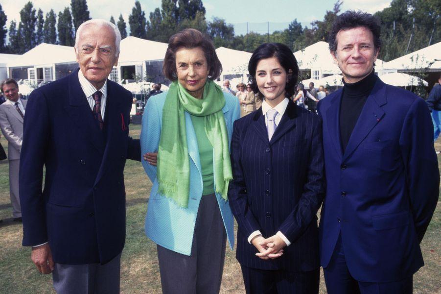 Liliane Bettencourt et son époux André Bettencourt avec Cristiana Reali et Francis Huster lors du Trophée Lancôme en septembre 1996 à Saint-Nom-la-Bretèche.