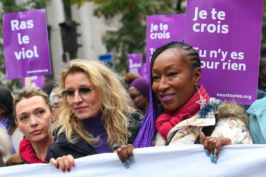 En tête de cortège,Anne Marivin, Alexandra Lamy et Nadège Beausson-Diagne, à Paris, samedi.