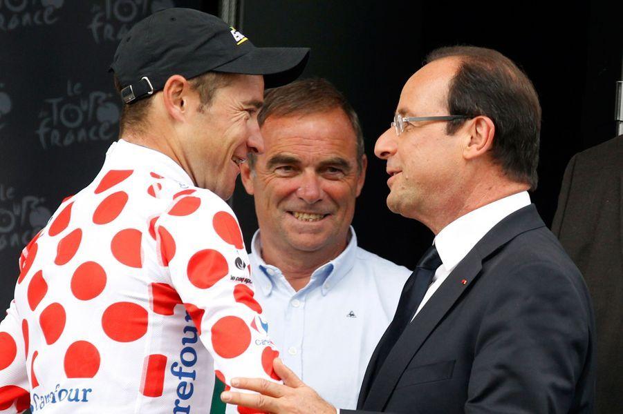 Après l'étape entre Blagnac et Brive-La-Gaillarde,le 20 juillet 2012, François Hollande retrouve Thomas Voeckler, à l'époque maillot à pois.