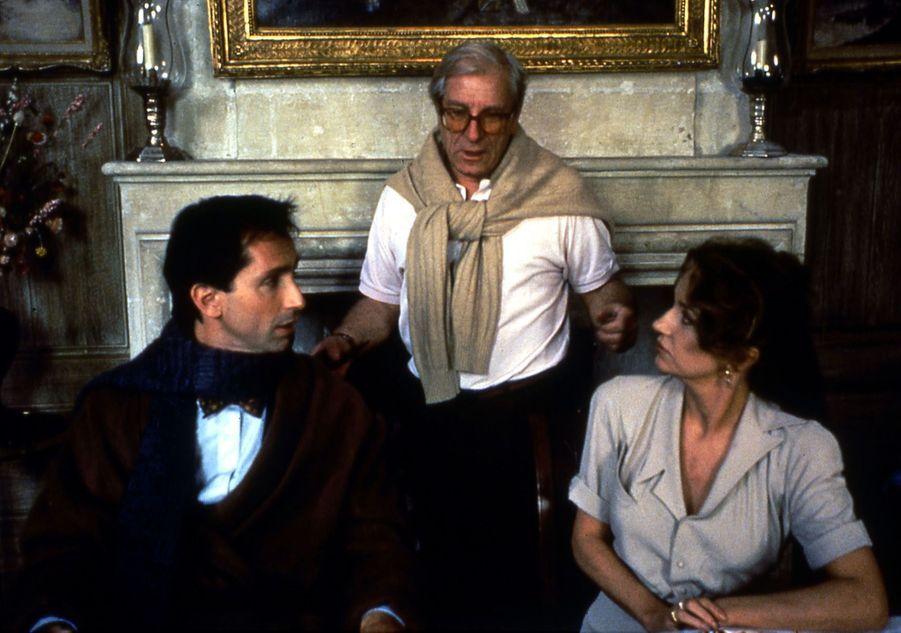 Jean Poiret réalisateur dirigeant son épouse Caroline Cellier et Thierry Lhermitte, dans le film «Le zebre», en 1992.