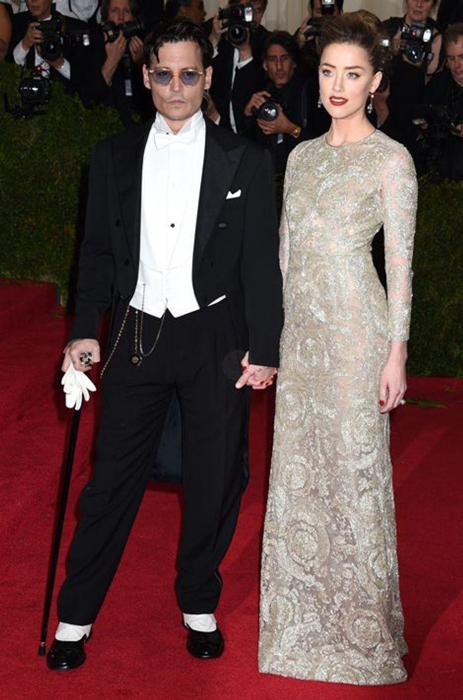 Johnny Depp et Amber Heard (en Giambattista Valli)