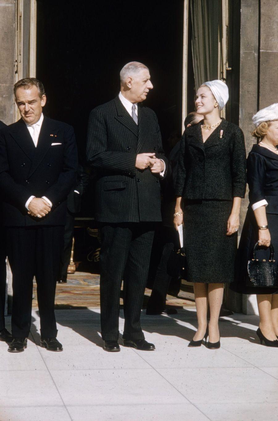 Grace de Monaco et le prince Rainier III de Monaco reçus par le président Charles de Gaulle, au Palais del'Elysée,en octobre 1959.