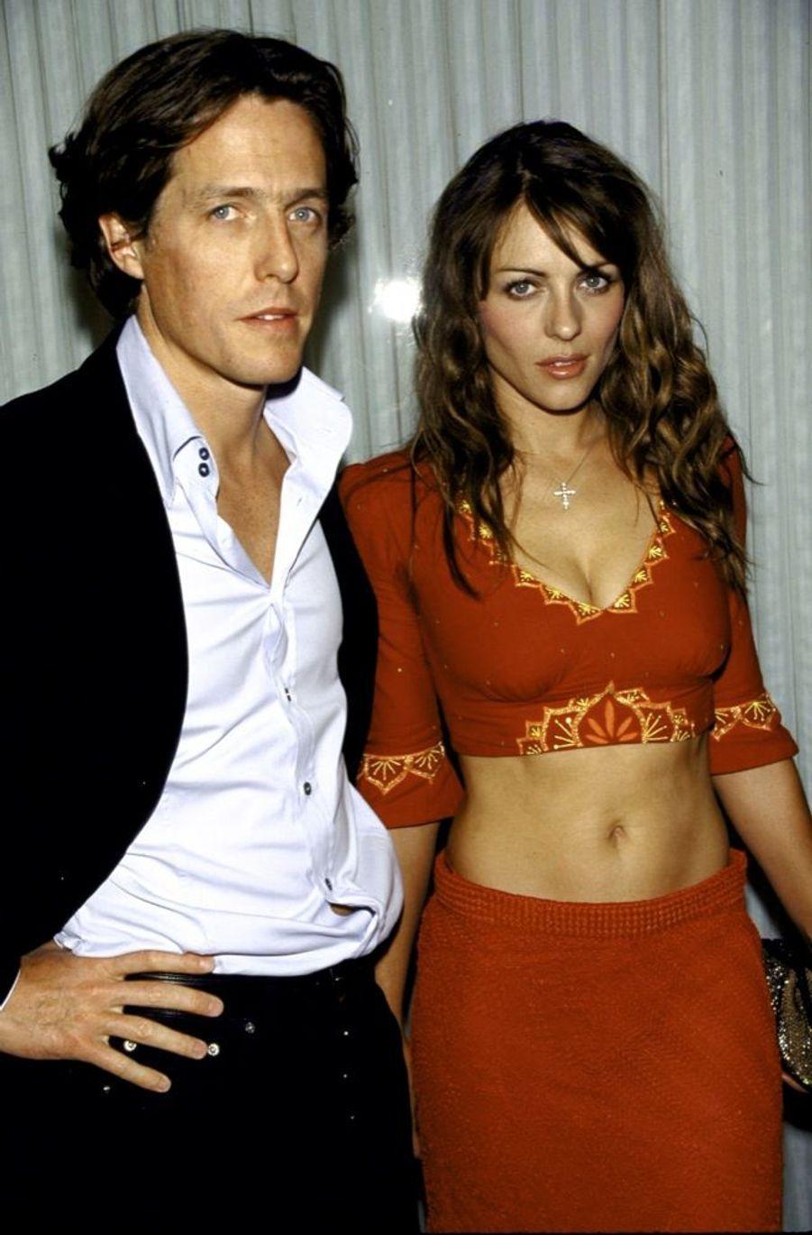 Elizabeth Hurley et Hugh Grant, lors d'une soirée donnée à la veille des Golden Globes, en janvier2000.