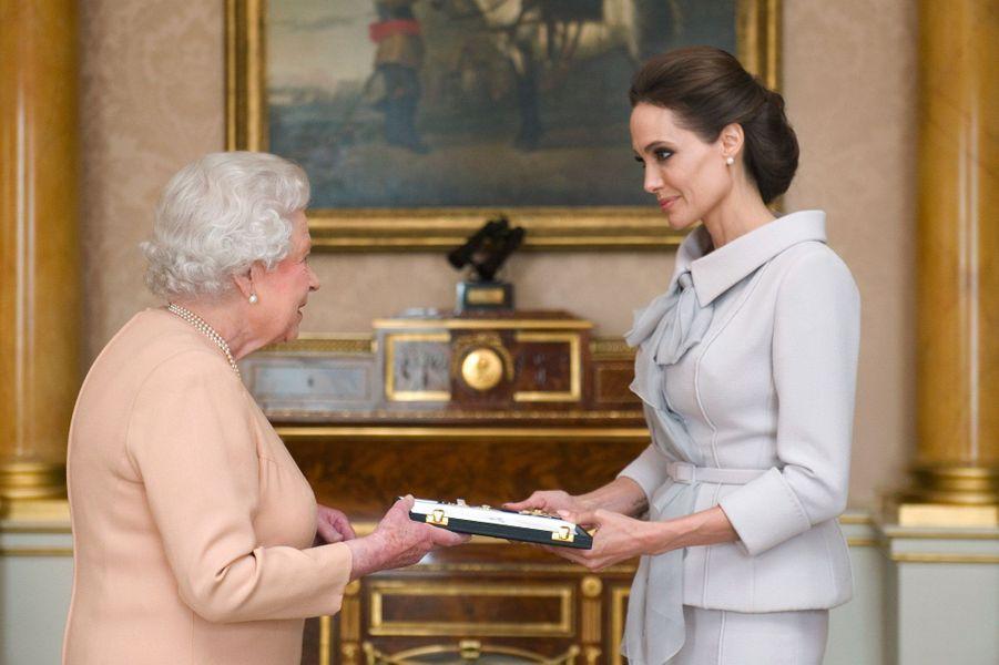 Avec la Reine d'Angleterre.
