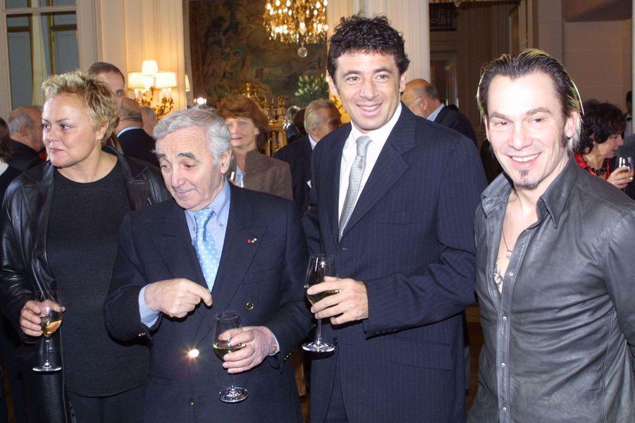 En 2001, à l'Hôtel Crillon avec Muriel Robin, Patrick Bruel et Florent Pagny.