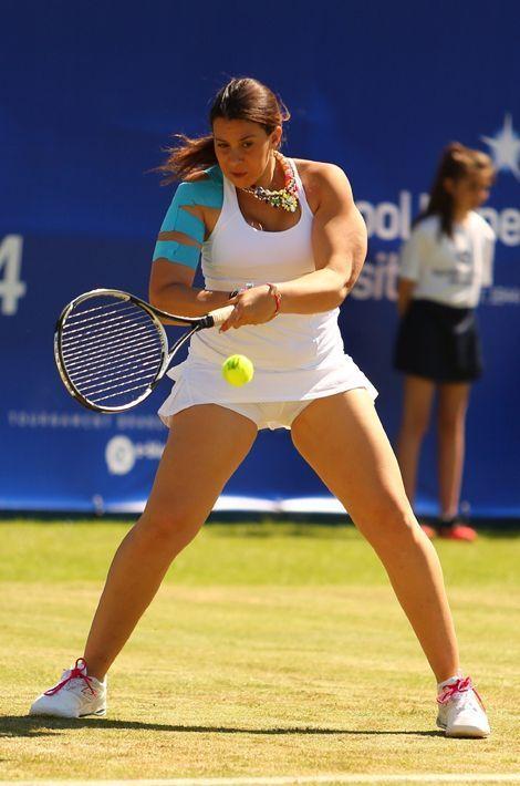 Marion Bartoli à un match amical au tournoi de Liverpool le 20 juin 2014. Depuis 2013, l'ex-joueuse de tennis a perdu 13 kilos.