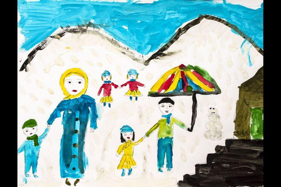 Reyhanli, Hatay, Turquie - Sujet pour cette session: Dessinez l'avenir que vous espérez. Dessin par un étudiant de la Free Syria School. Une famille dans la neige.