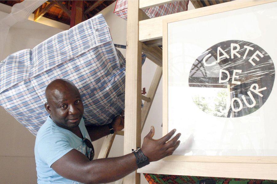 Si l'art est l'expression d'un phénomène à travers une image forte, alors ce Camerounais est un véritable artiste. En 1996, il n'hésite pas à se présenter à l'aéroport de Roissy-CDG, équipé d'une cartouchière pleine… de caramel en barre. Politique, à la biennale de Lyon en 2000, il montre à l'aide d'un avion et d'un bateau l'exploitation des richesses de l'Afrique par les mêmes qui refusent la migration des Africains. Ecologiste, il lave deux drapeaux américains à la main et les suspend à un fil, pour dénoncer les refus de rectification du protocole de Kyoto, en 2001. Toguo a un côté avant-gardiste, et ne s'est jamais empêché de pointer du doigt ce qui le dérange.