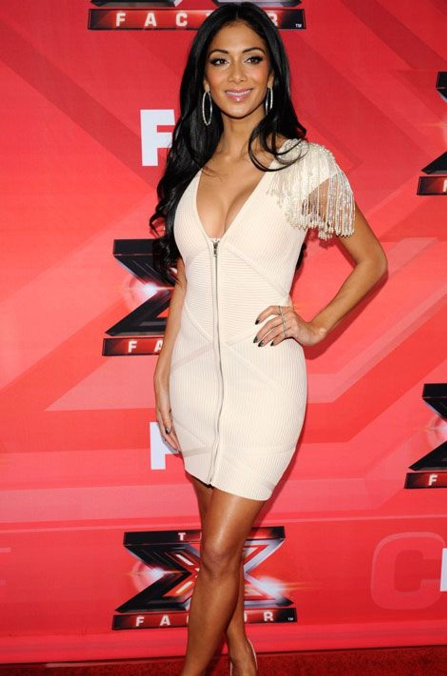 A une conférence de presse de l'émission «The X Factor» à Los Angeles en 2011.