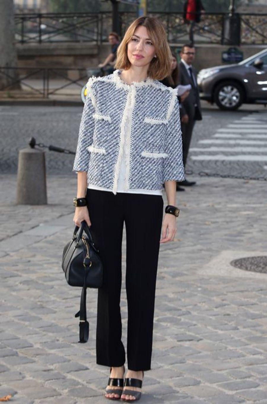 En Louis Vuitton au défilé Vuitton, en octobre 2013