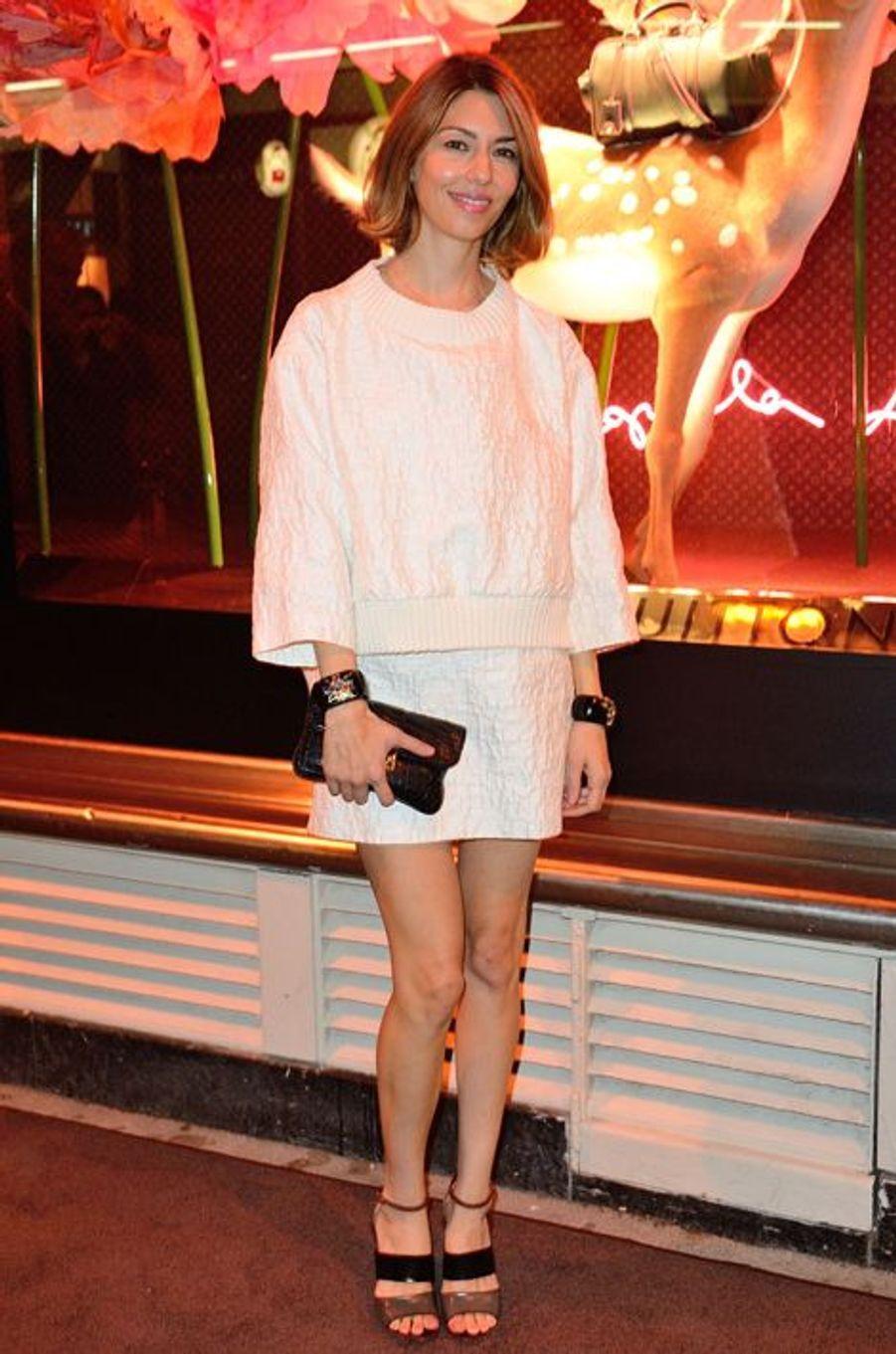 En Vuitton à un cocktail Vuitton, en octobre 2013