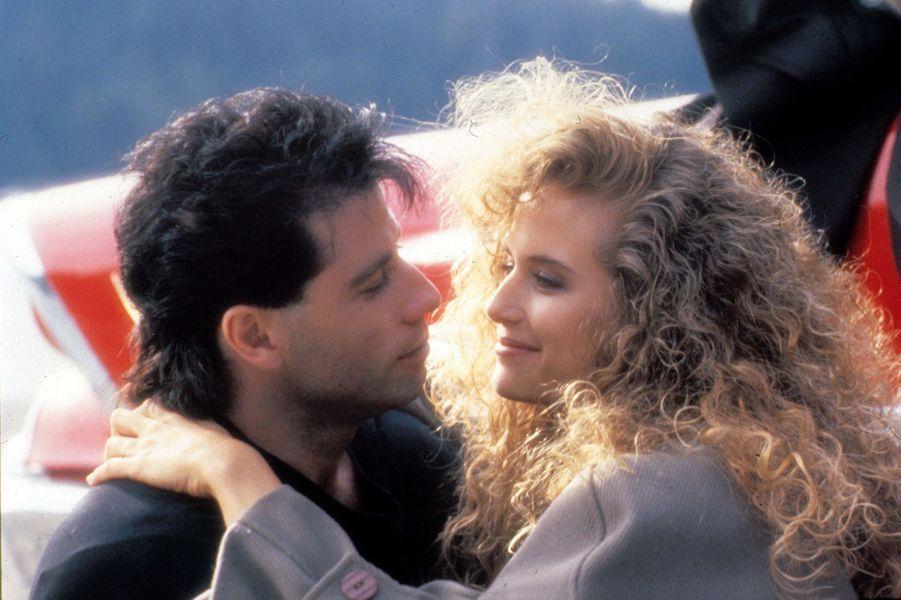 """Kelly Preston et John Travolta dans le film """"Les experts"""" en 1987, sur le tournage duquel le couple s'est rencontré."""