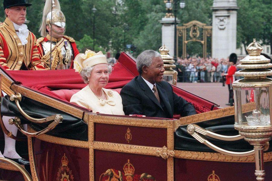 Avec la reine Elisabeth, en juillet 1996